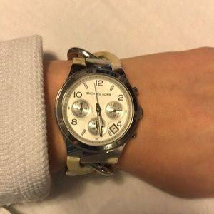 Michael Kors bone and silver watch.